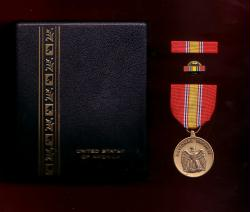 US National Defense medal in case with ribbon bar and lapel pin