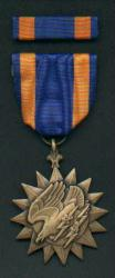 Air Medal with ribbon bar showing Eagle with Lightning Bolts