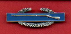 Combat Infantry Badge showing wreath and rifle CIB