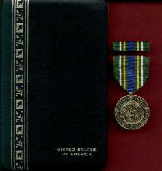 Korean Defense Award medal in case with ribbon bar and lapel pin