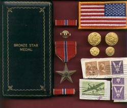 Genuine WWII Bronze Star medal in old style case with ribbon bar and lapel pin, Invasion money etc.